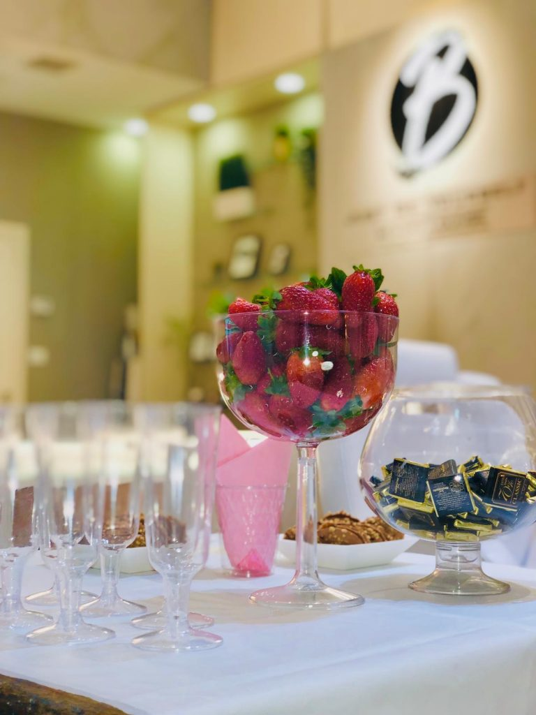 Table with champagne glasses and strawberries in a beauty institute